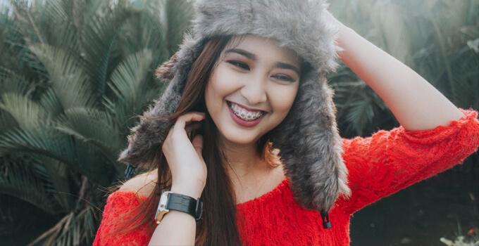 pretty filipina in a fur hat